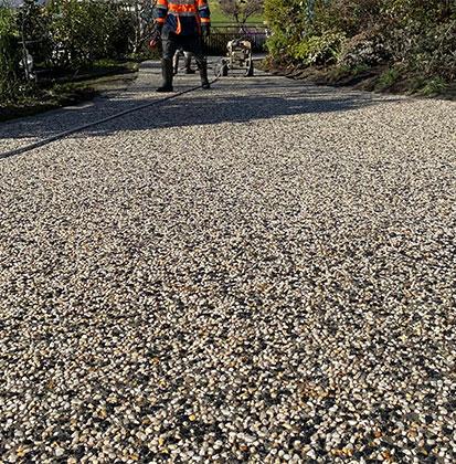 Con-Tek concrete pavement driveway employee checking