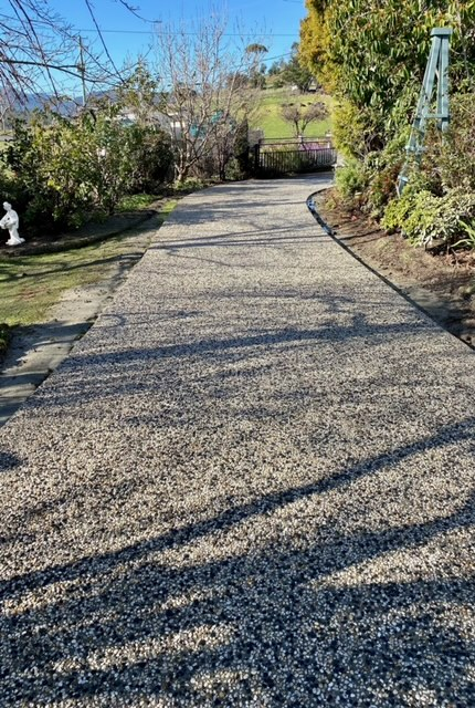 Con-Tek concrete pavement pathway near garden