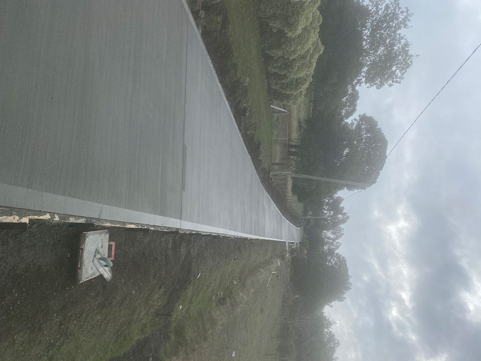 Con-Tek concrete pavement long pathway with trees