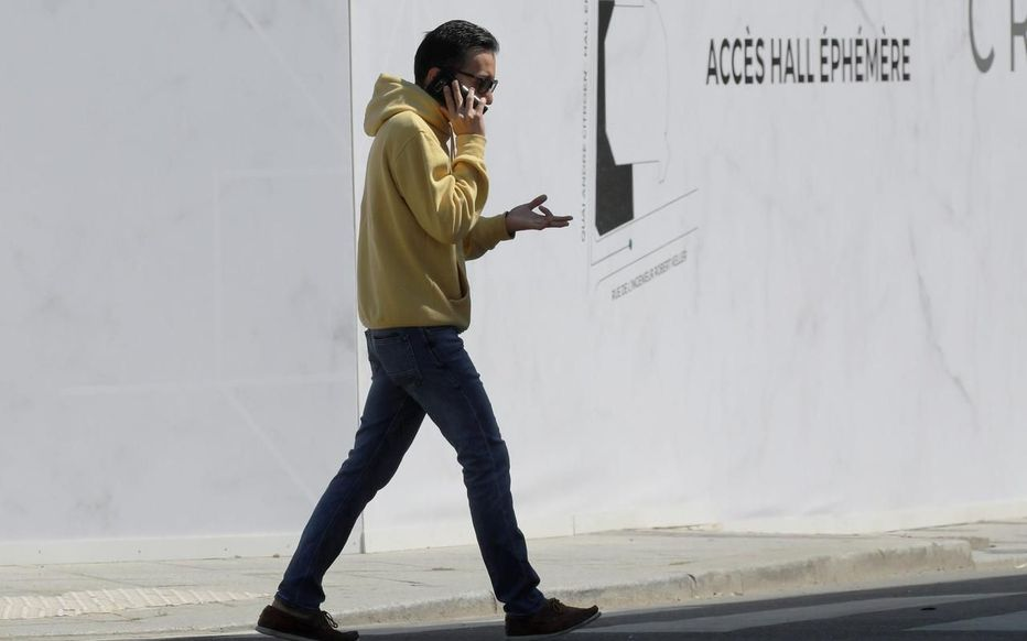 Man walking with a smartphone