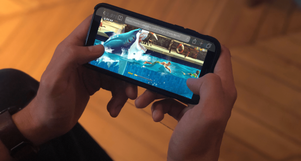 Smartphone showing Unbisoft's game Hungry Shark Evolution
