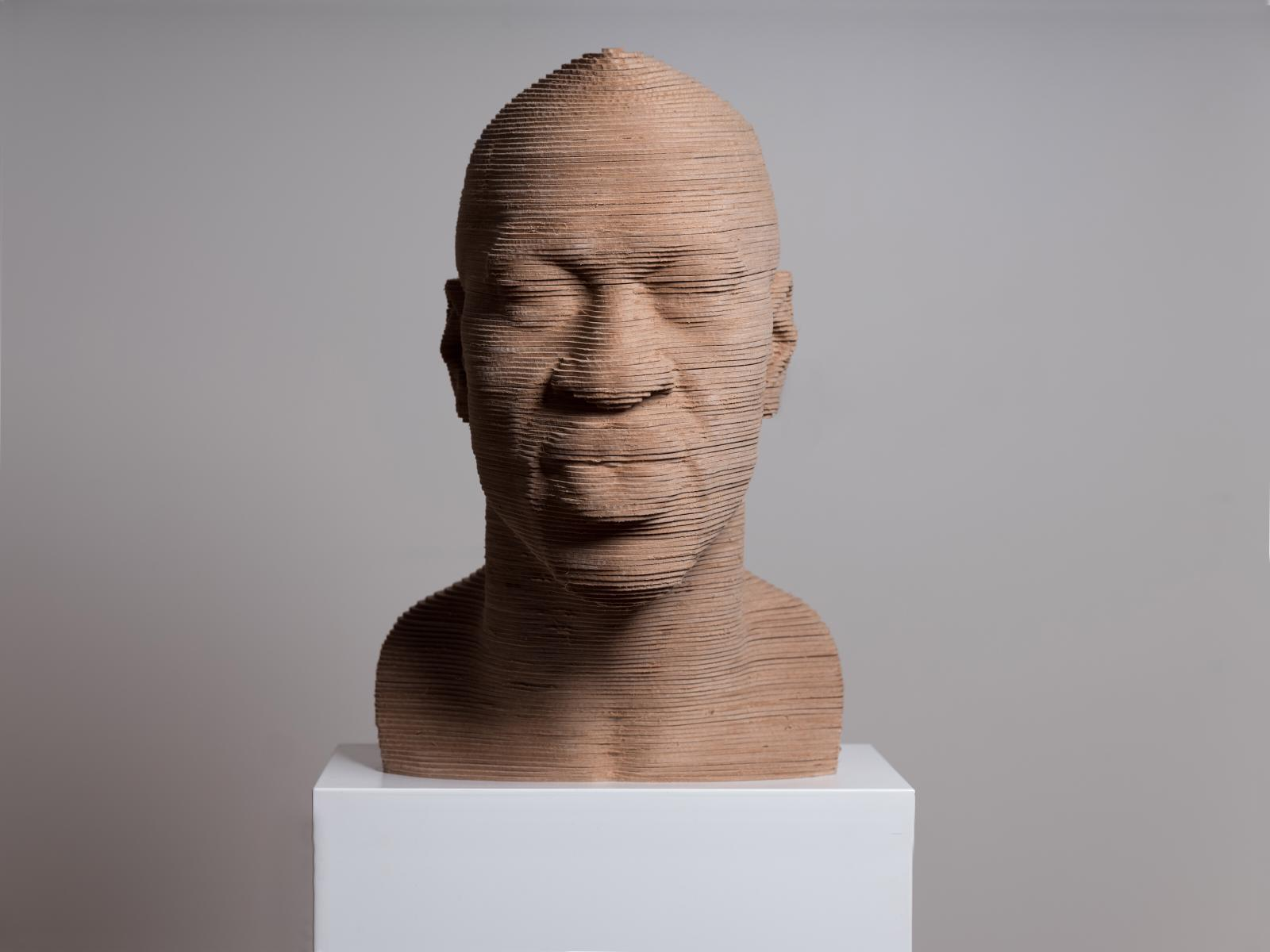 George Floyd Bust Sculpture Looking Forward. Made of layered wood on a white marble base.