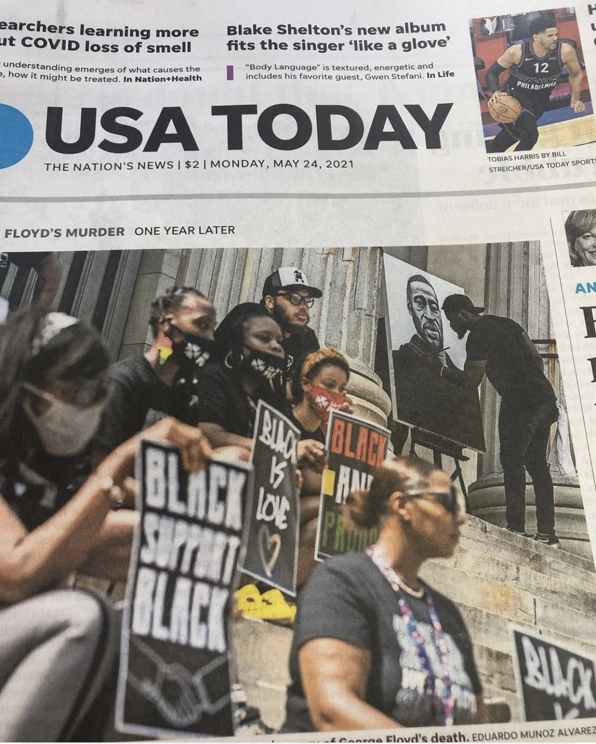 USA Today headline with Confront Art group members sitting on stone steps.
