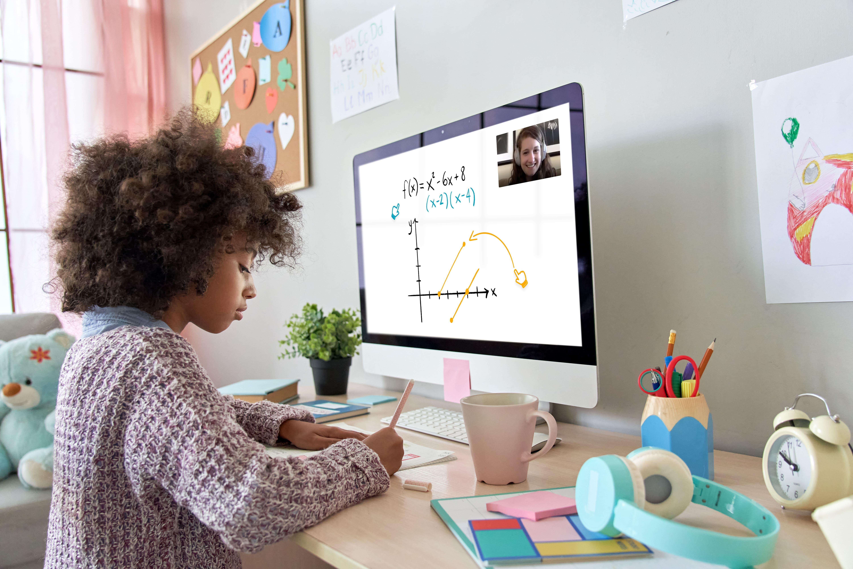 Girl Online Math Tutoring on Screen - Side View
