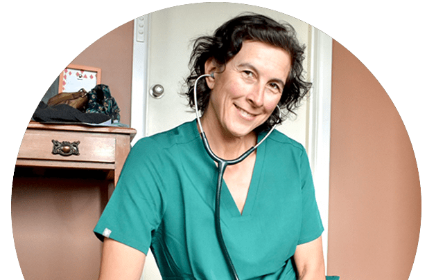cathy with stethoscope around neck in green vet gown