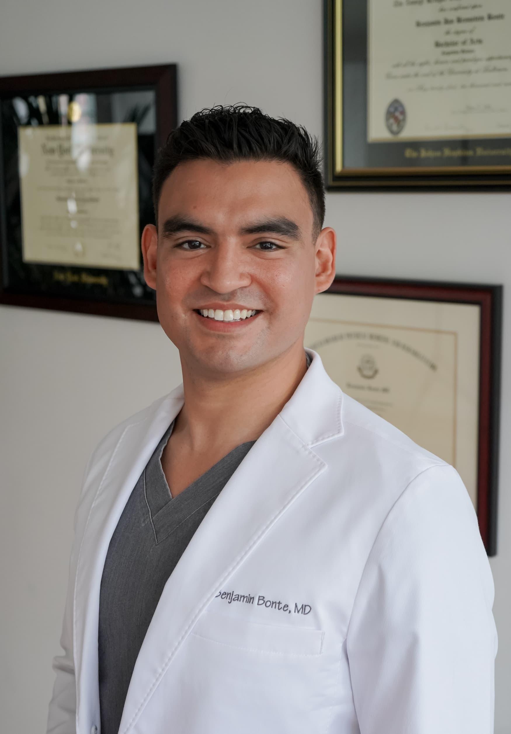 Dr. Bonte smiling in lab coat