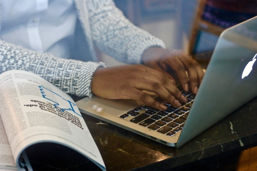 nonprofit board consultant writing in her nonprofit blog via her laptop.