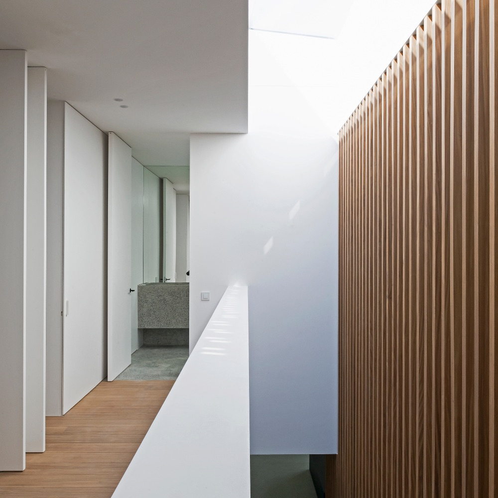 Modern interior with light white walls and light brown wood panelling