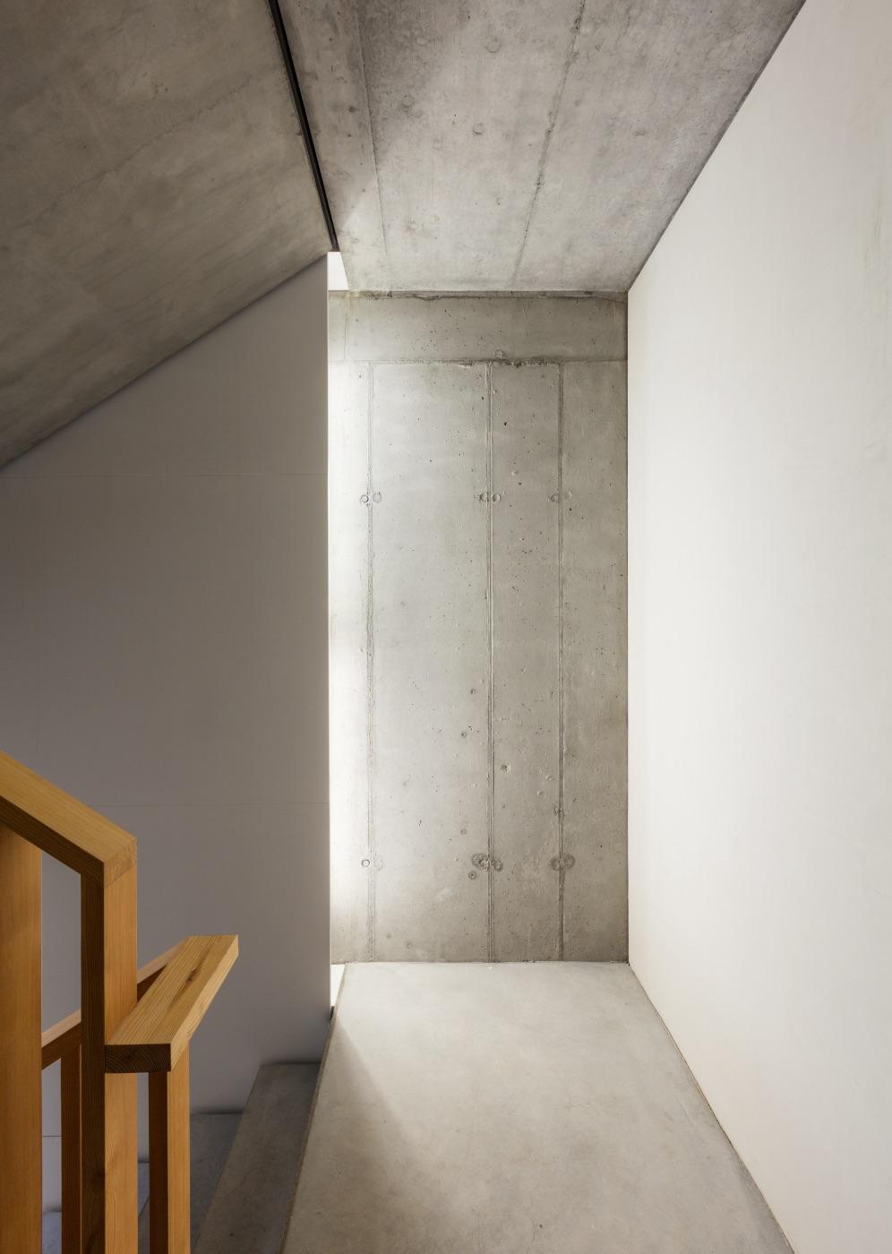 Mid development minimalist concrete wall interior with wooden panels