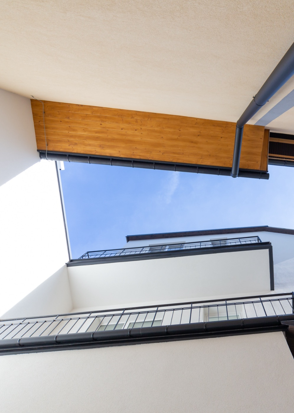Modern design architecture with camera facing upwards towards the sky