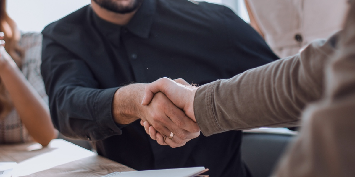 People agreeing on a deal, shaking hands
