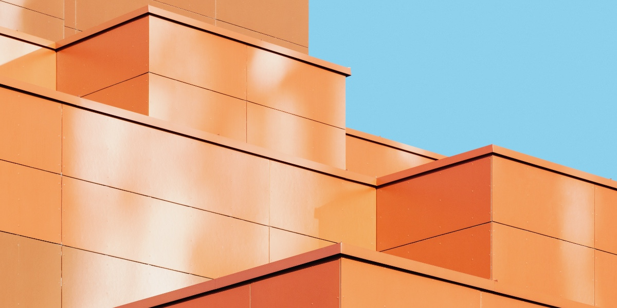 Abstract architecture, orange roof, metal facade