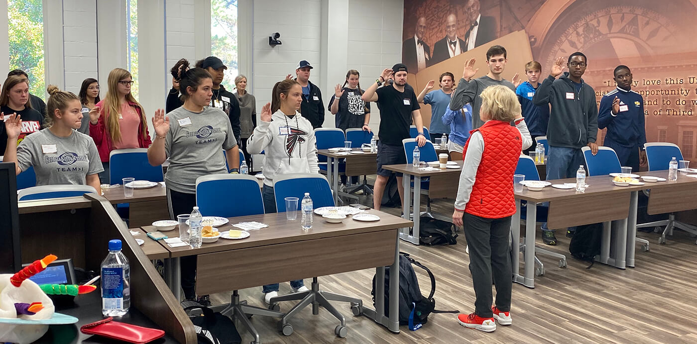 Collegiate Athletes participate in a Perfectly Polished class.