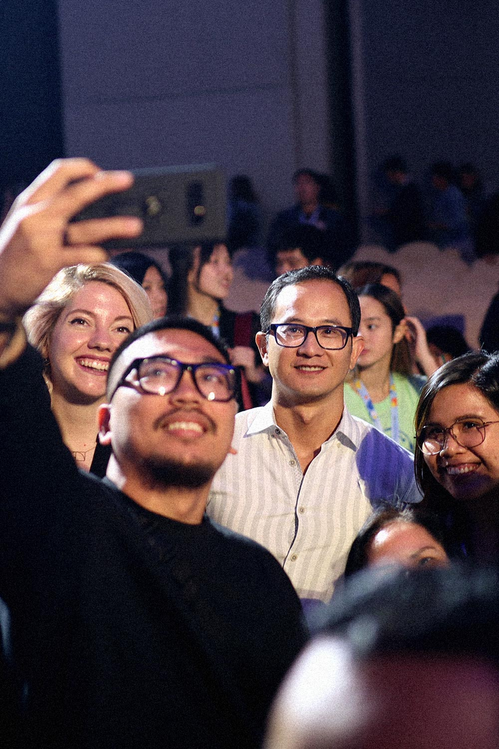 Audience taking photo with speaker from UX+ Conference 2019