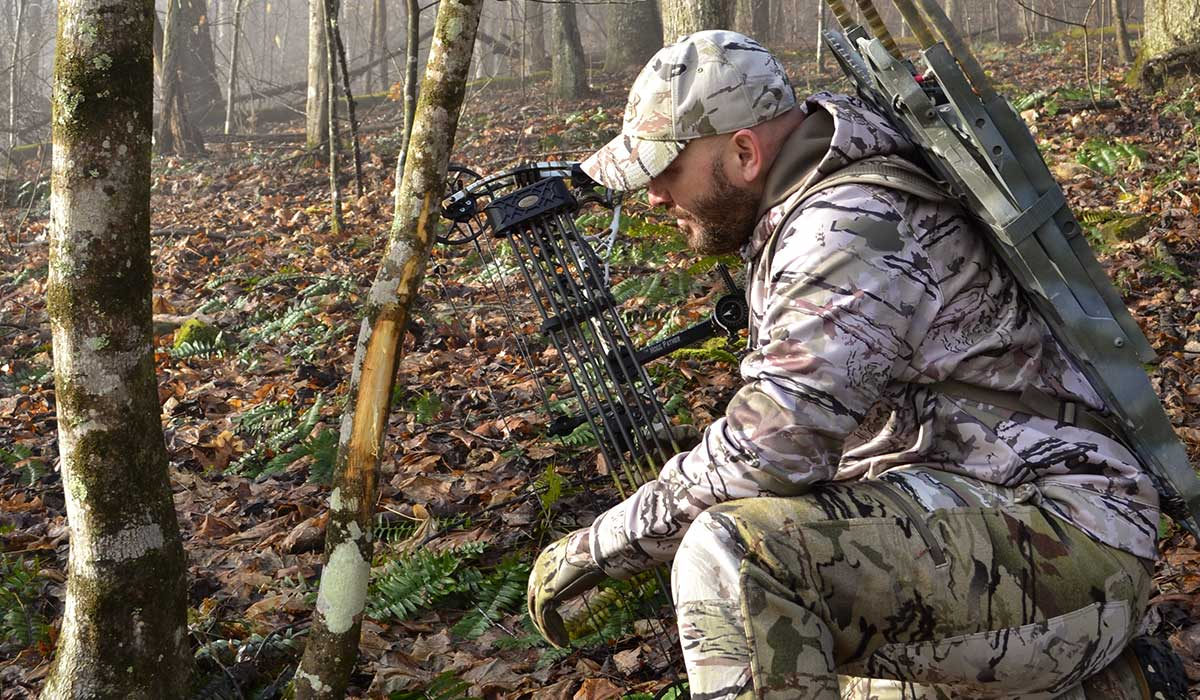 Checking trail cameras in buck bedding areas