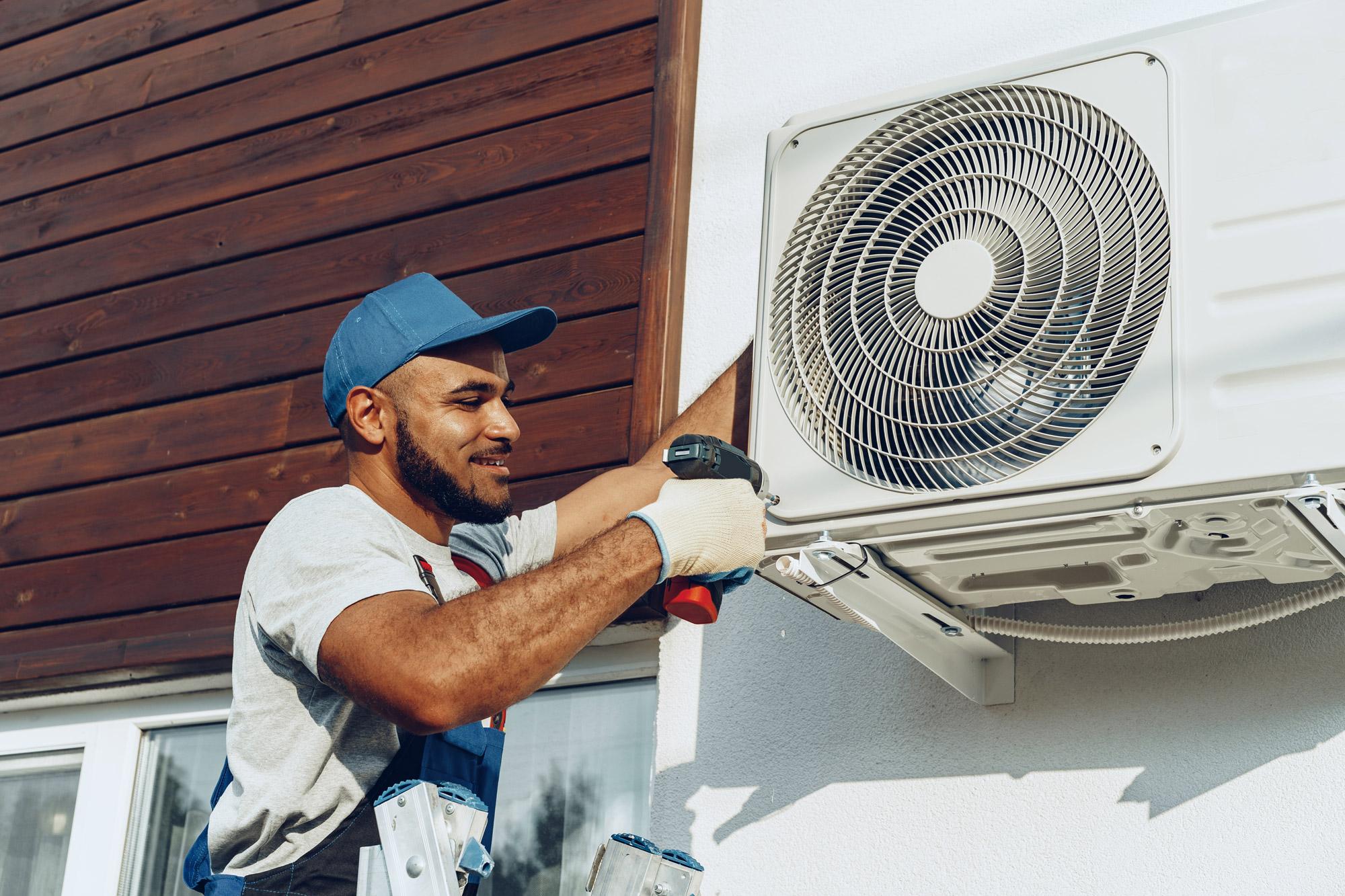 HVAC Technician Repairing HVAC unit outside