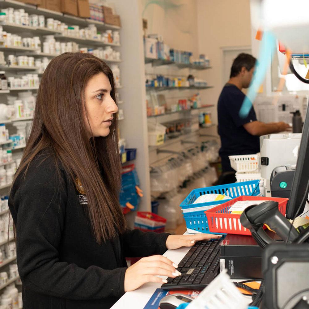 Employee filling prescriptions at PureCare Pharmacy.