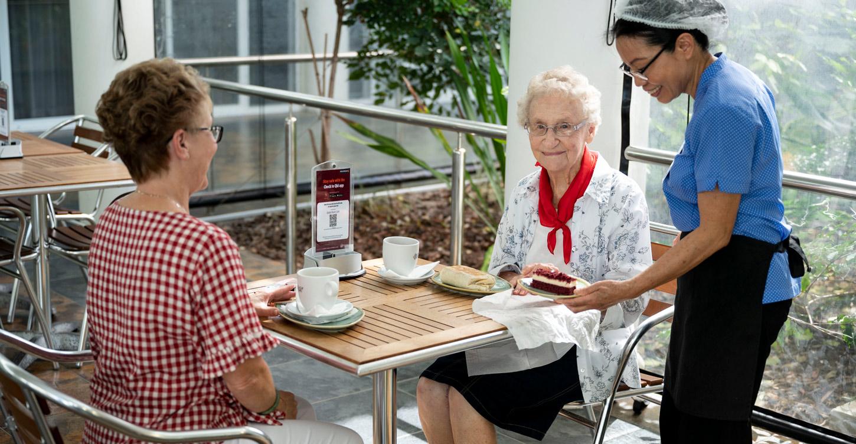 Good Shepherd Lodge resident enjoying lunch at the cafe
