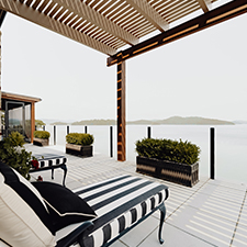 Custom-built patio overlooking the lake by LA Constriction, an East Tennessee custom home builder.