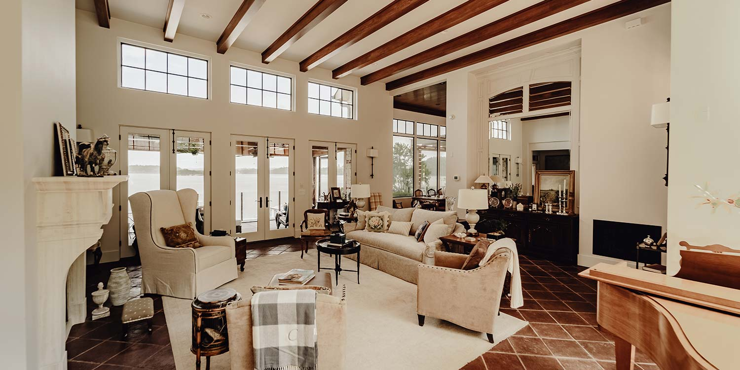 Custom living area by LA Construction overlooking the lake.
