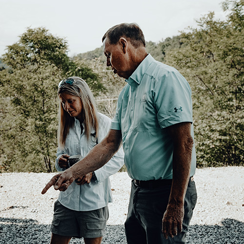 LA Construction, an East Tennessee custom home builder, discussing a project with a client.