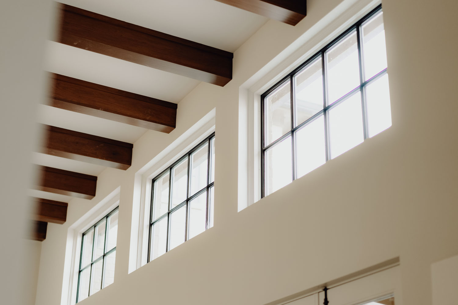 Custom wooden beams and windows by LA Construction custom home builders.