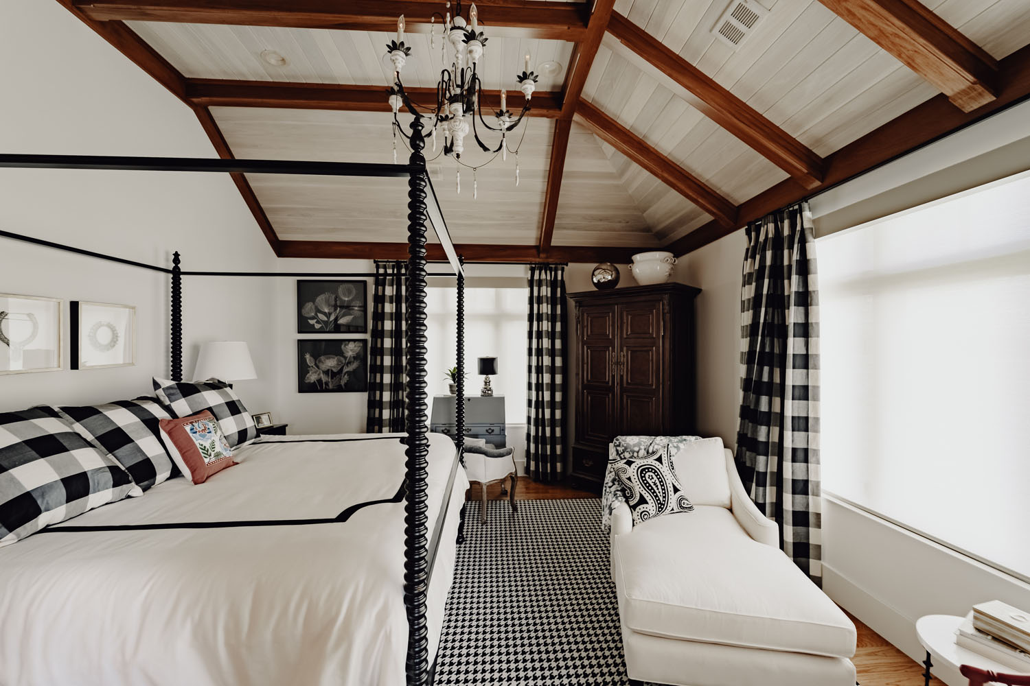 Custom bedroom with exposed wooden beams and high-end finishes throughout by LA Construction custom home builders.
