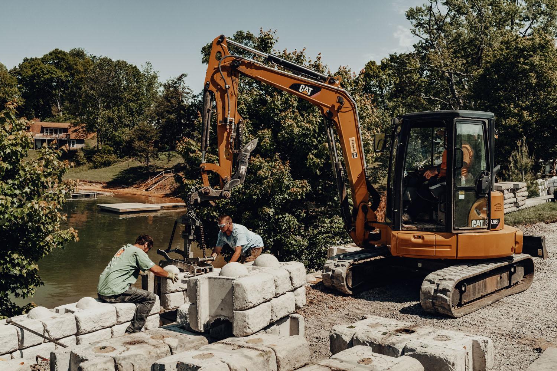LA Construction team work to set concrete blocks.