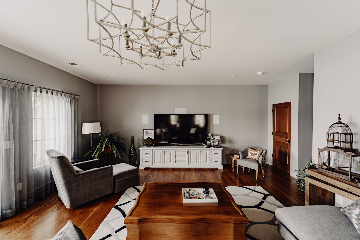 Custom-built living room with fine furnishings and hardwood floors by LA Construction.