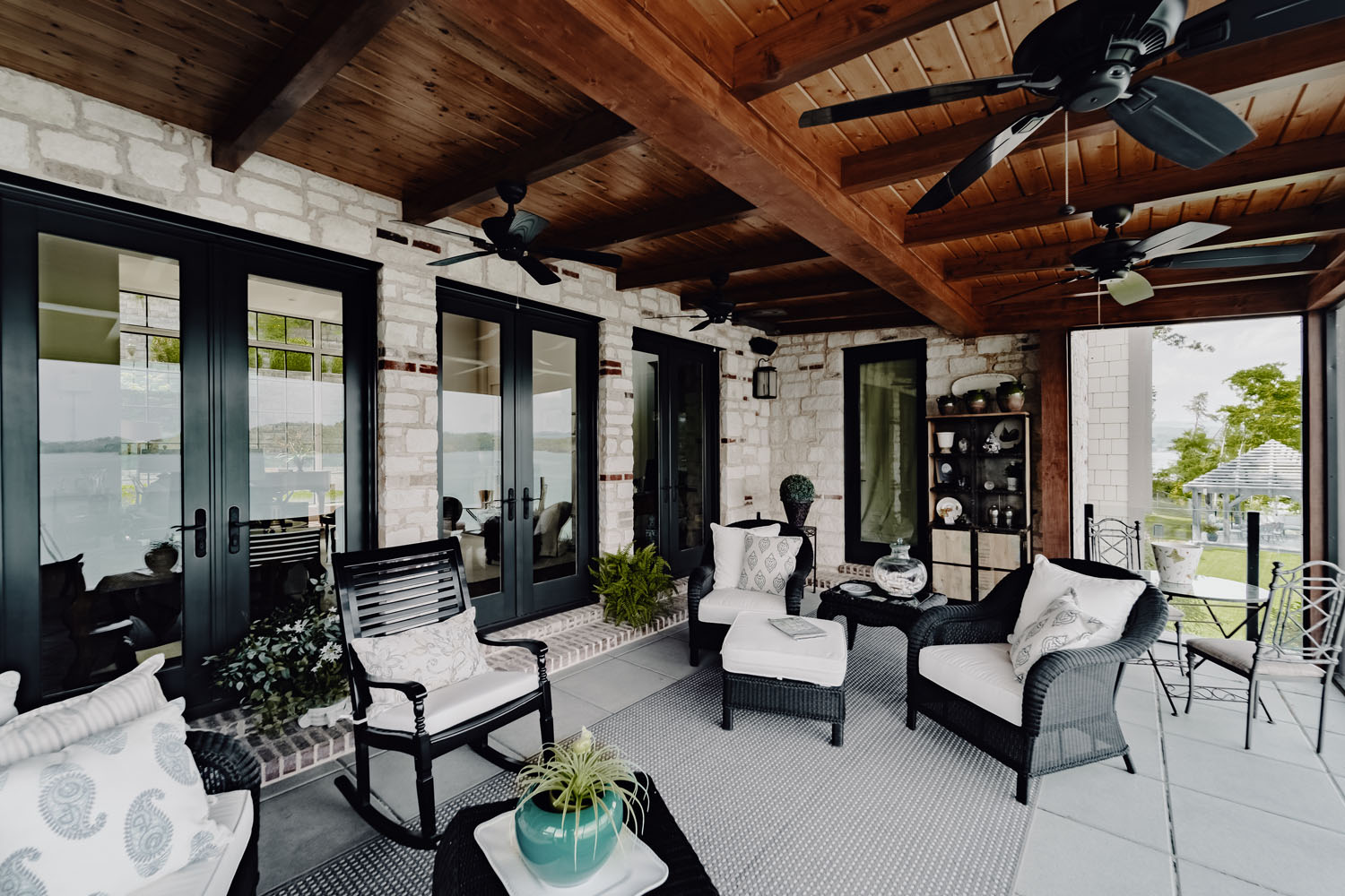 Custom outdoor patio with exposed wooden beams and ceiling by LA Construction custom home builders.