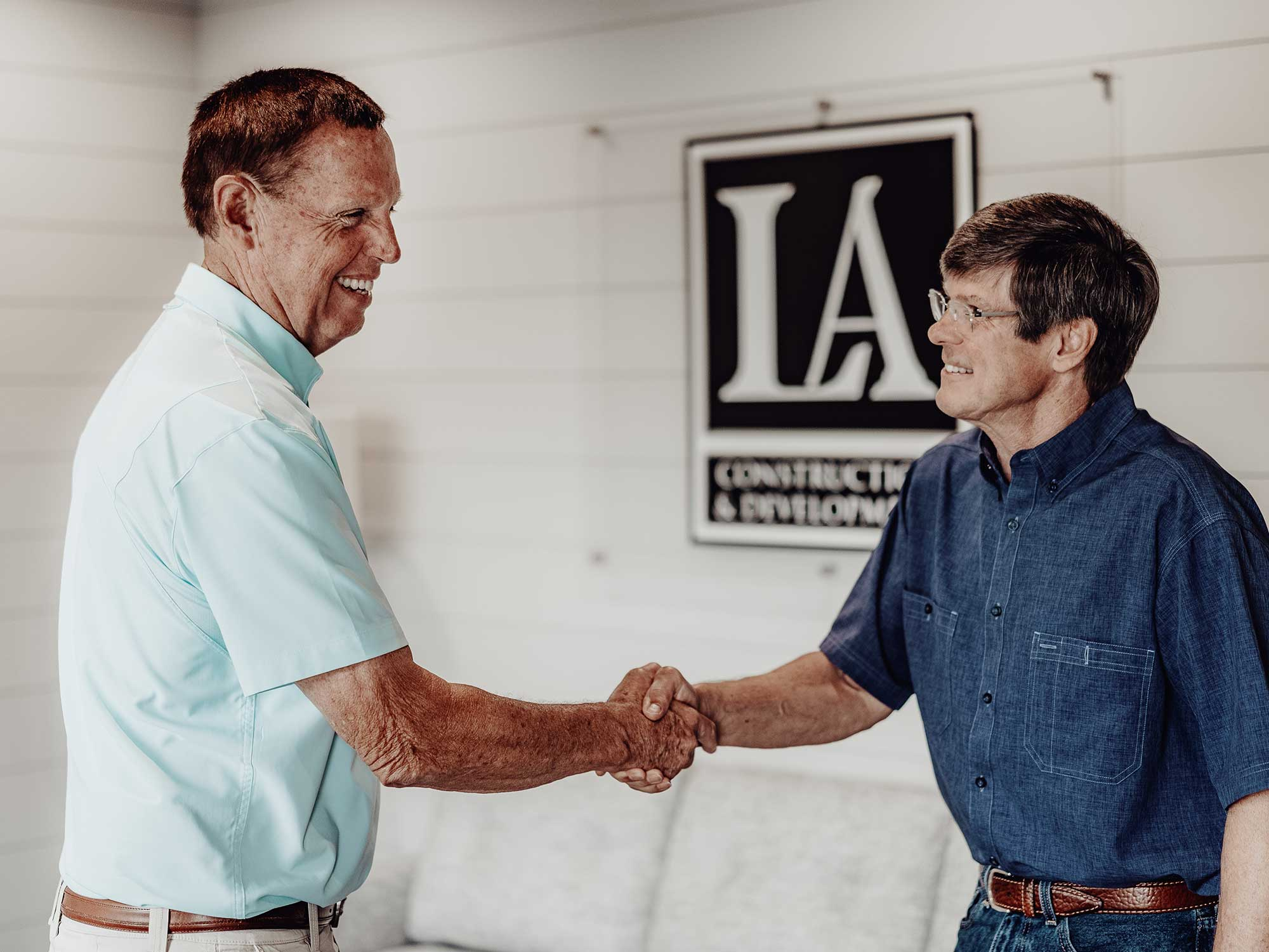 Larry shaking hands with an LA Construction client. As custom home builders, we care about the relationships we build with our customers.