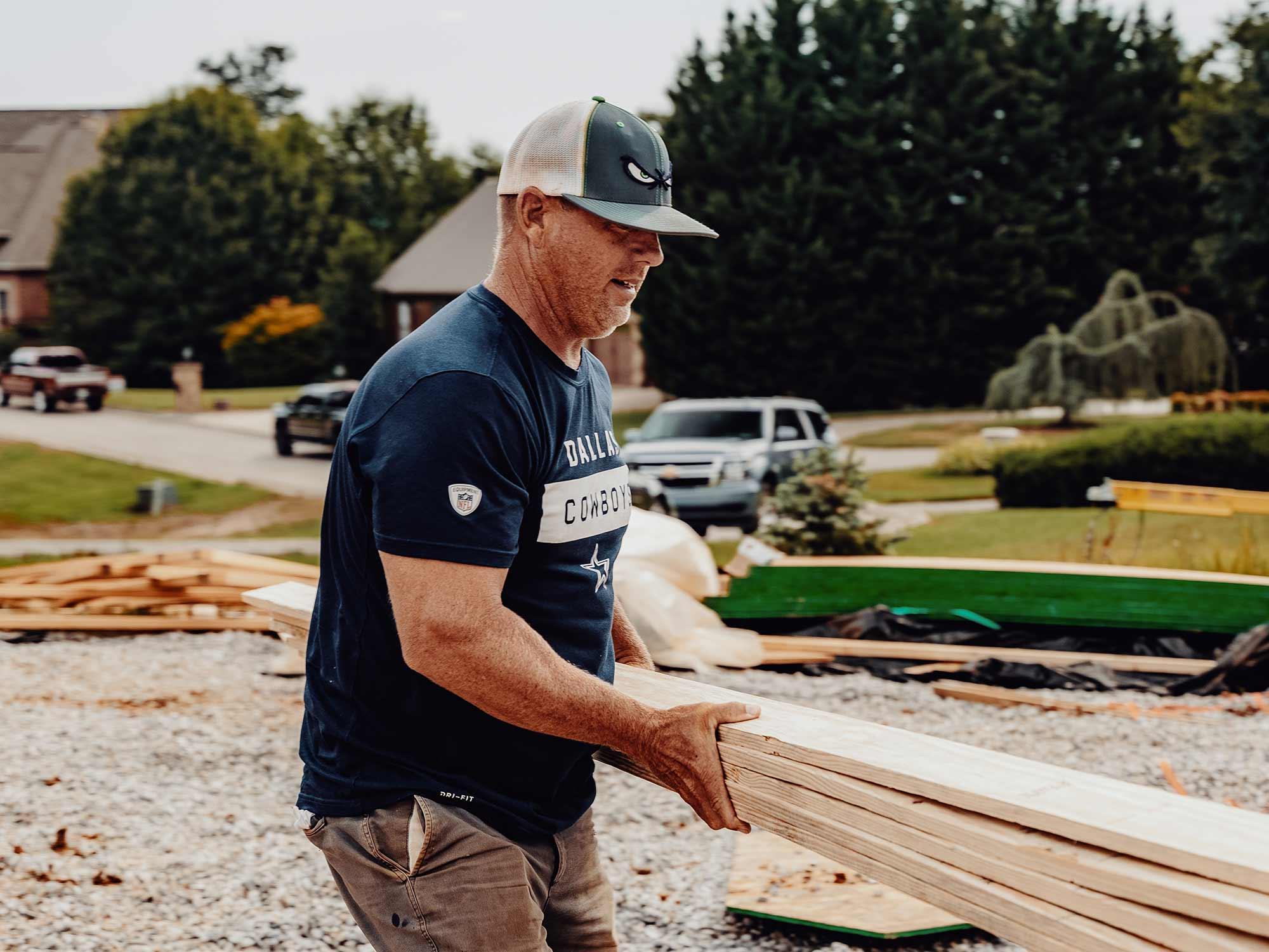 LA Construction team member at work building a custom home.
