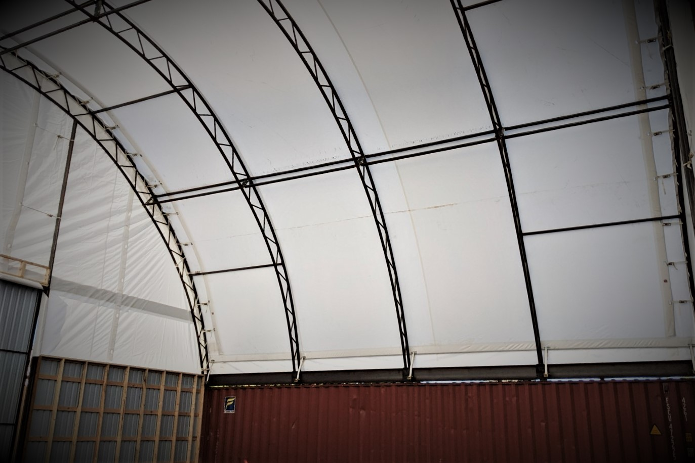 inside fabric building showing HSS steel frame and steel doors