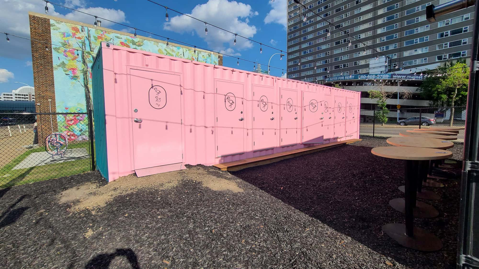 bespoke washroom conversion with pink shipping containers in an event space