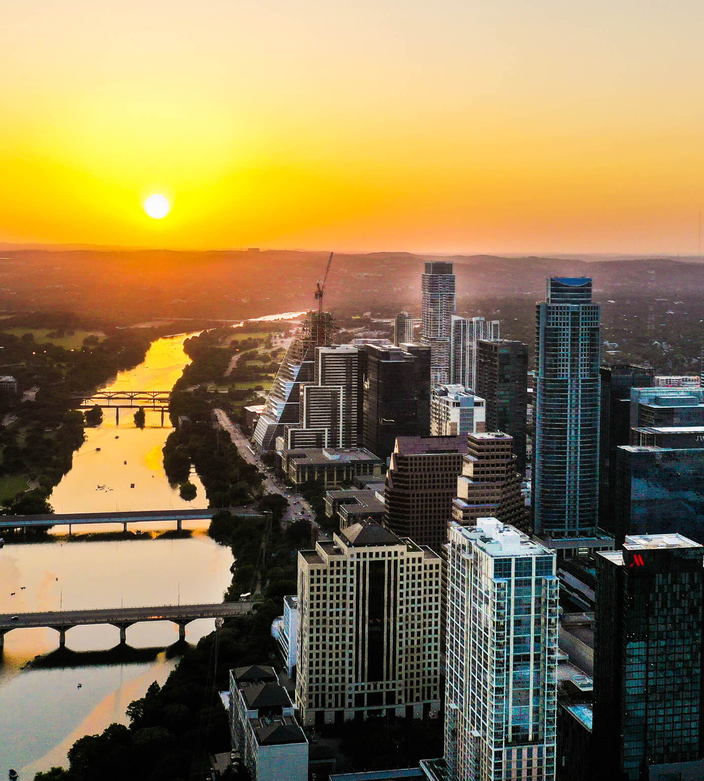 downtown Austin Texas with a view of the sunset over the Colorado River