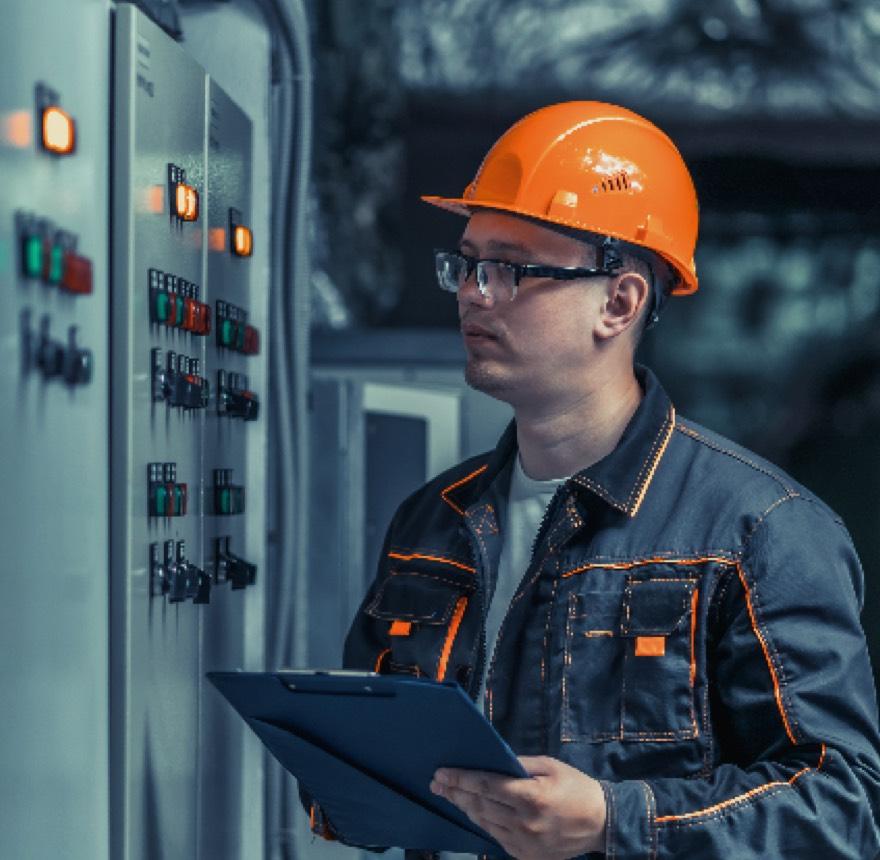 Switchgear employee inspecting control unit
