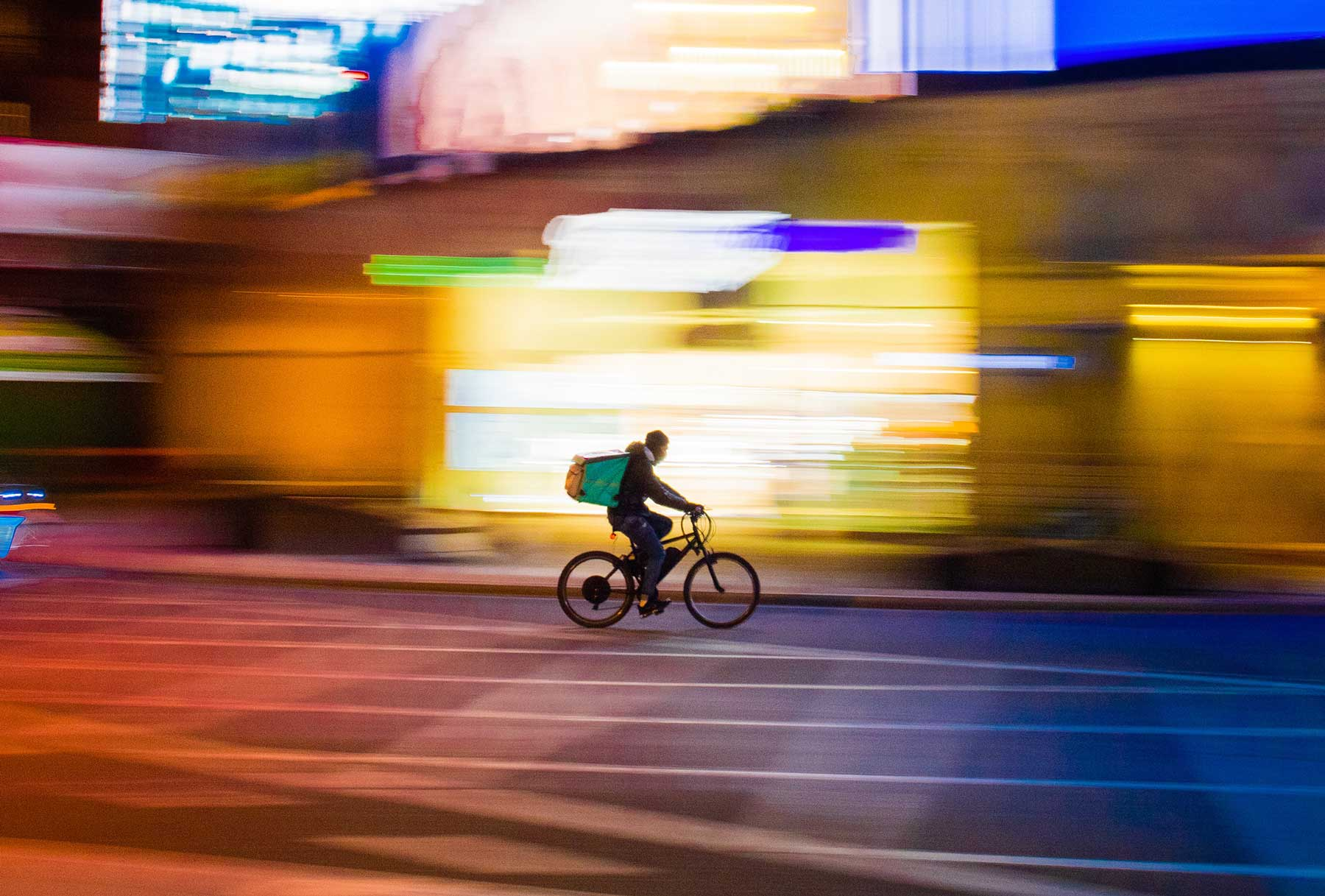 Quick Commerce Rider on a bike with colorful background