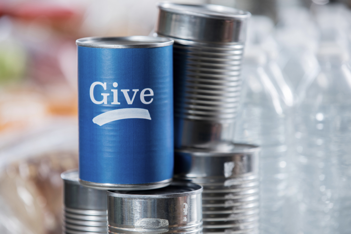 """A Stack of Cans That Say """"Give"""" From Feed Nova Scotia"""