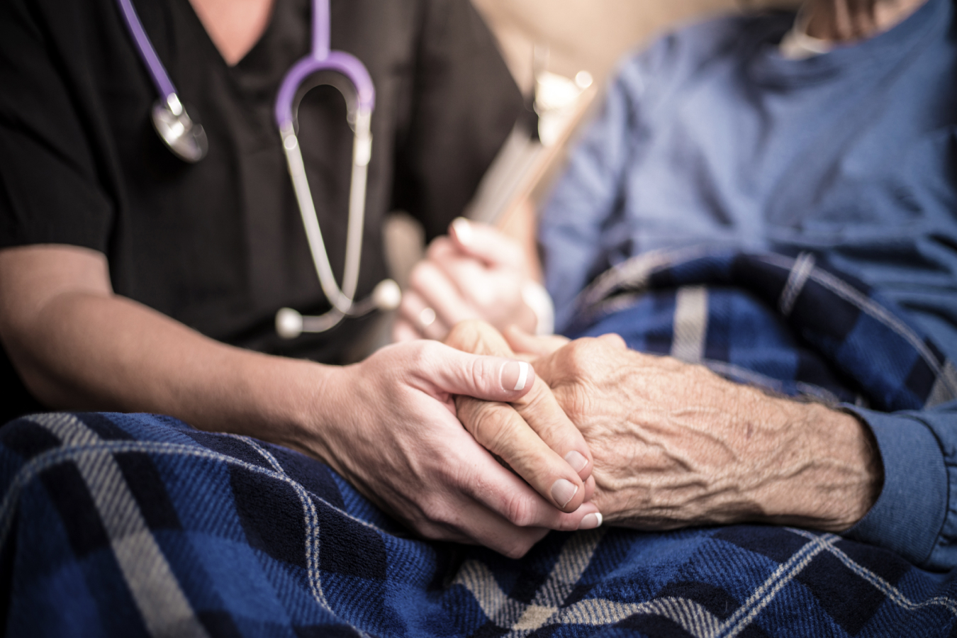 A Health Care Worker Comforting a Patient at Hospice Halifax