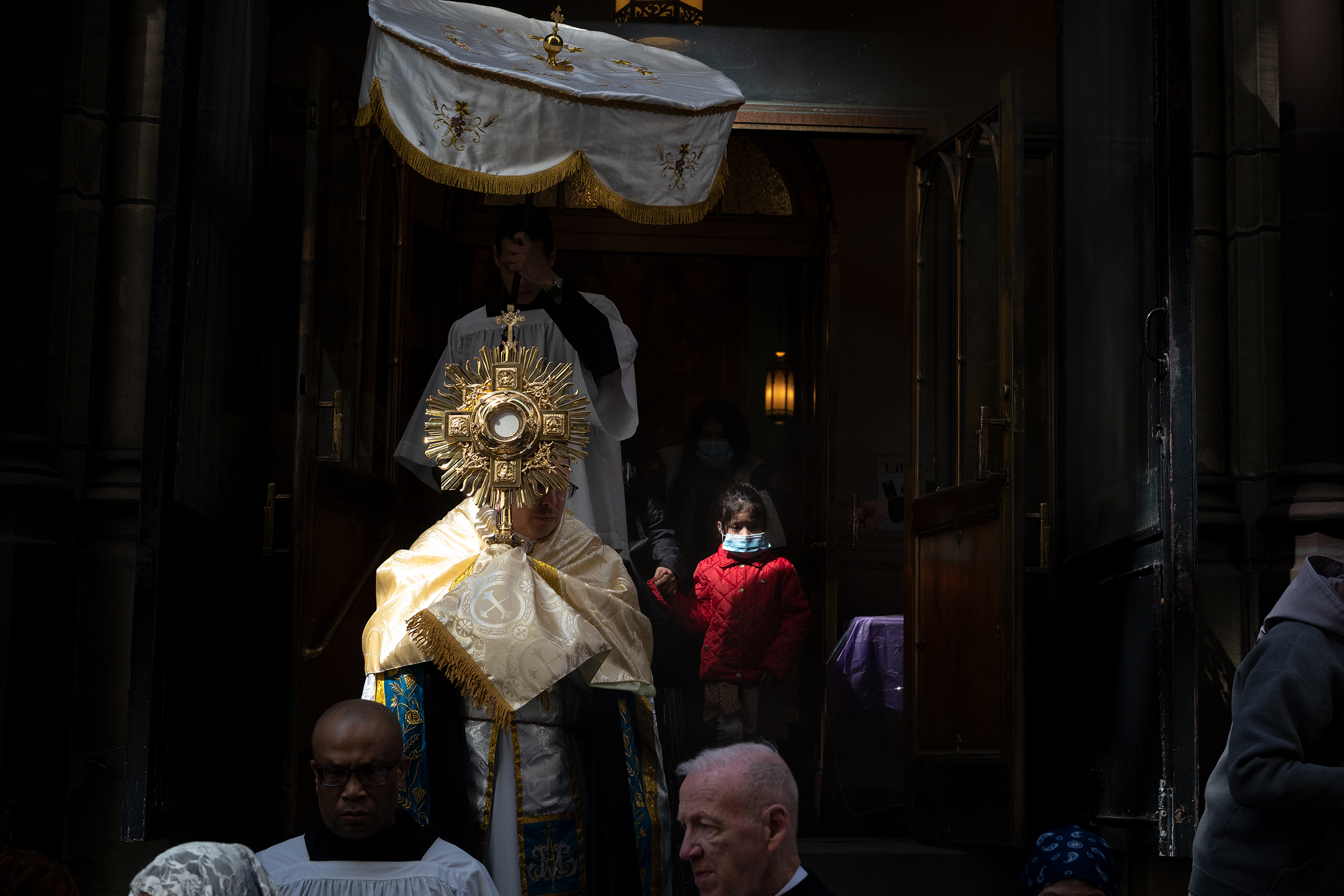 Father John Miara, pastor of the Shrine of the Holy Innocents leads a Eucharistic Procession on December 28, 2020 in New York's Garment District. [Jeffrey Bruno]