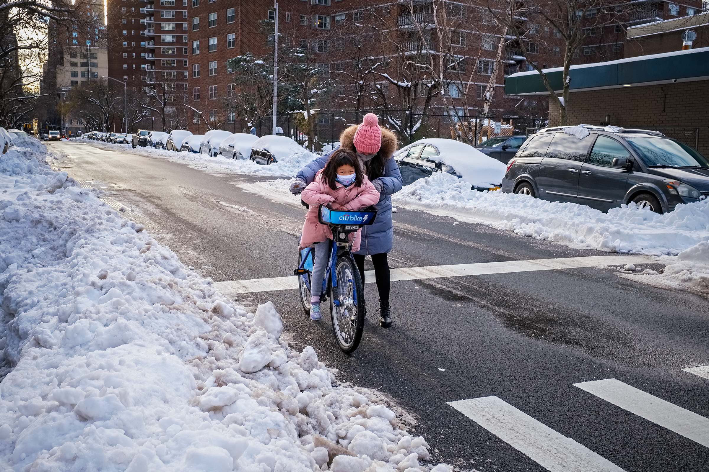 A young girl and her mom adventure out in the cold in New York City's Chelsea section. [David Levy]