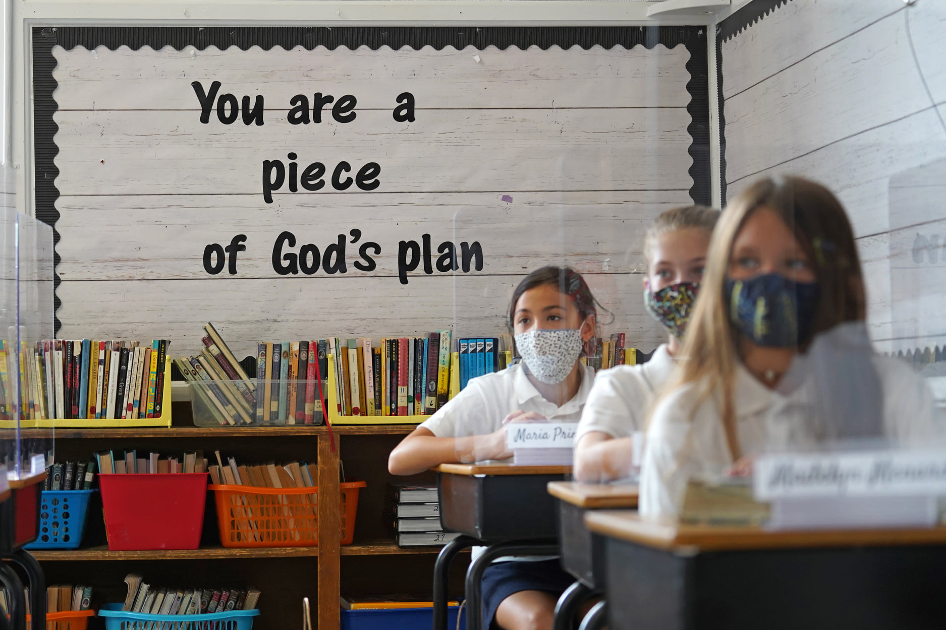 Sixth-grade students sit behind plexiglass partitions on the first day of the new school year, on September 8, 2020. Catholic schools were heralded for safety, efficiency and quality education during the pandemic. [Gregory A. Shemitz]