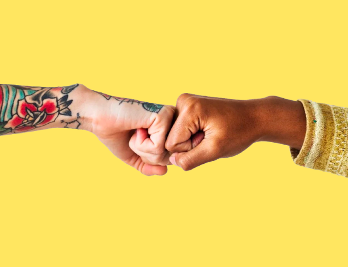 People giving each other a fist bump