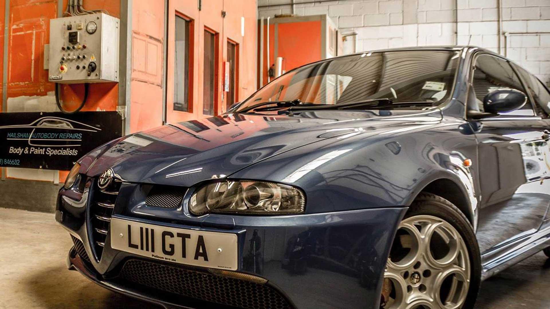 An Alfa Romeo being repaired in Hailsham Autobody's Garage