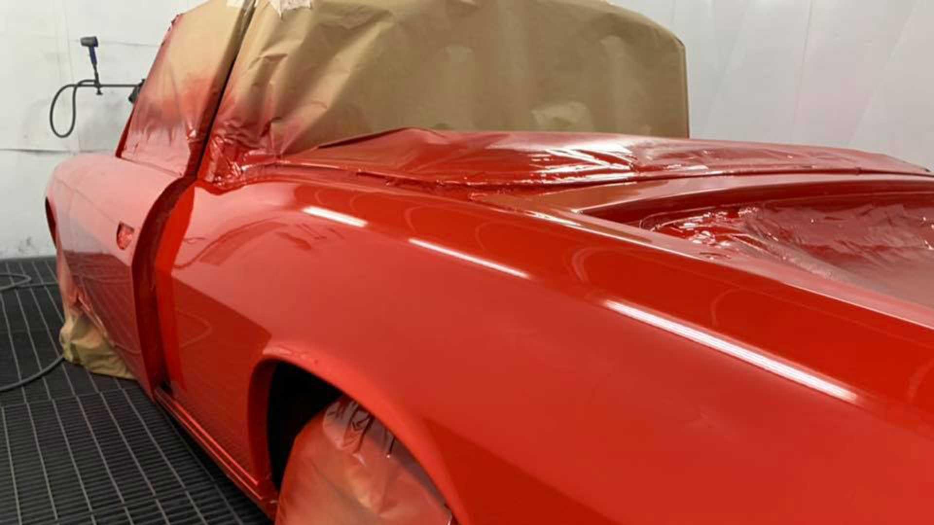 A red car being re-sprayed
