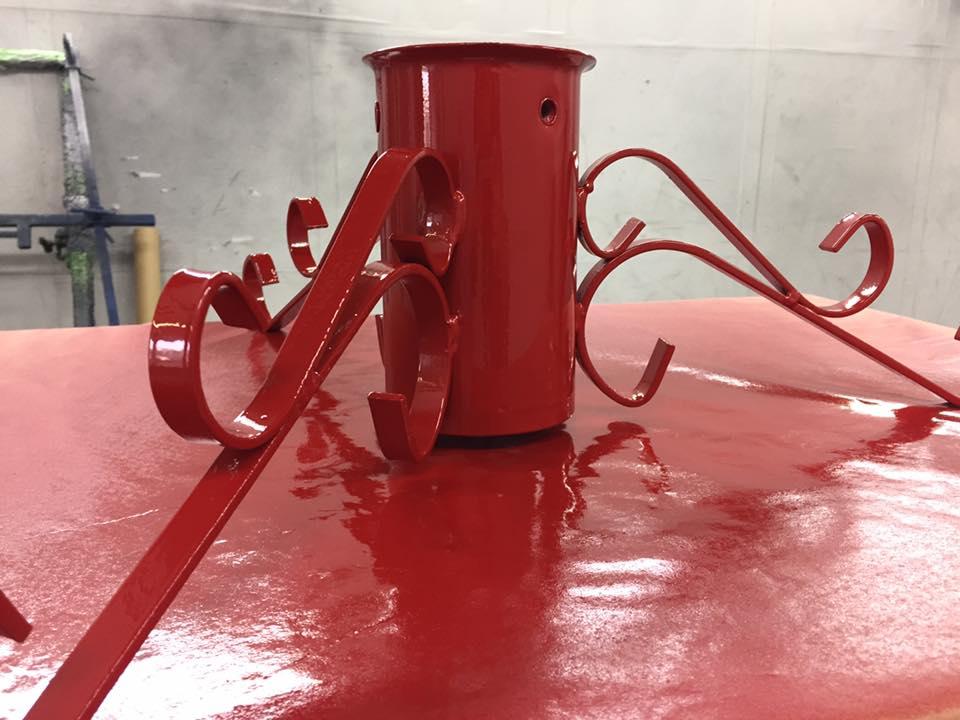 An item of garden furniture being sprayed in the workshop