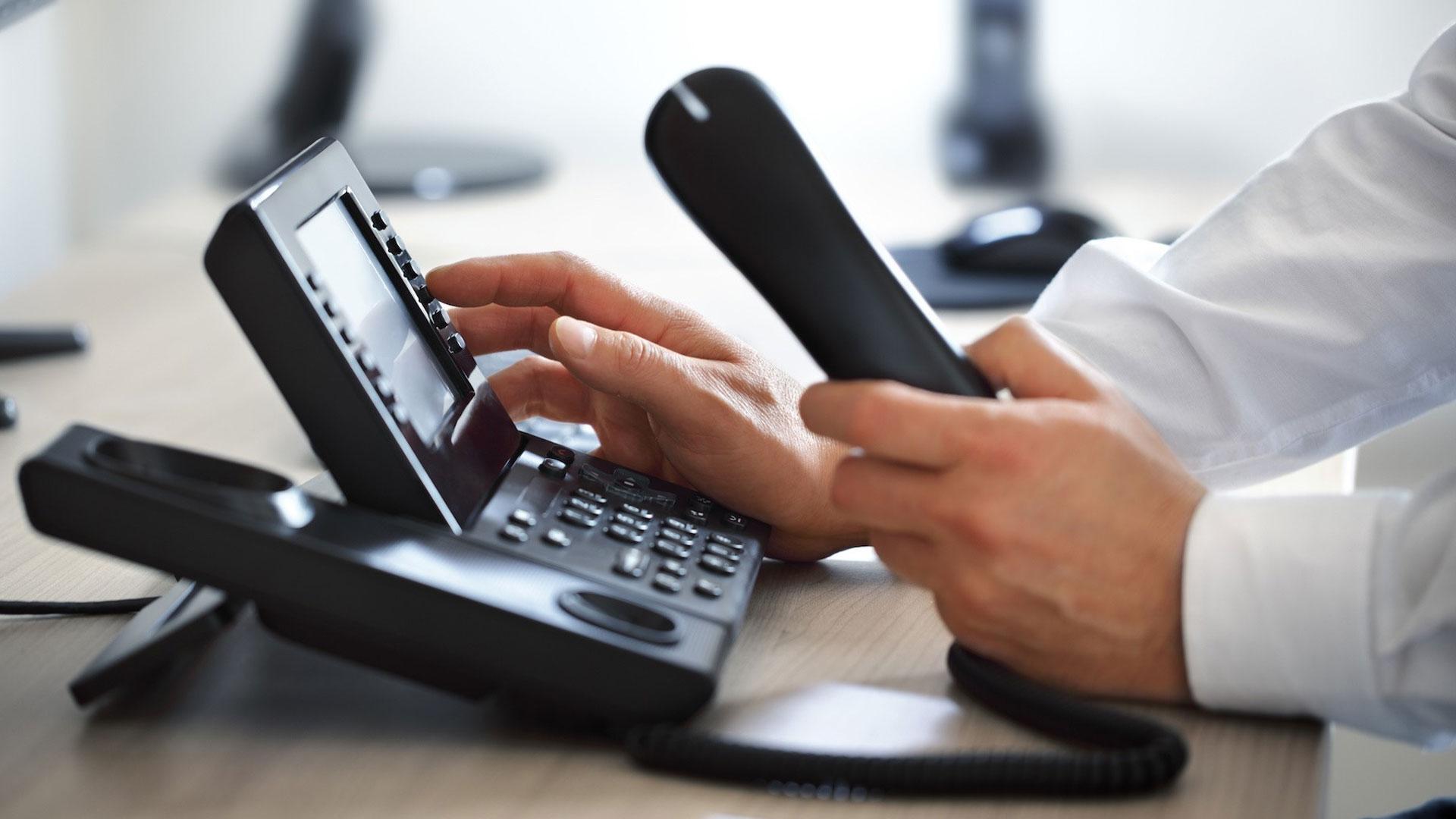 business man using a landline to make calls
