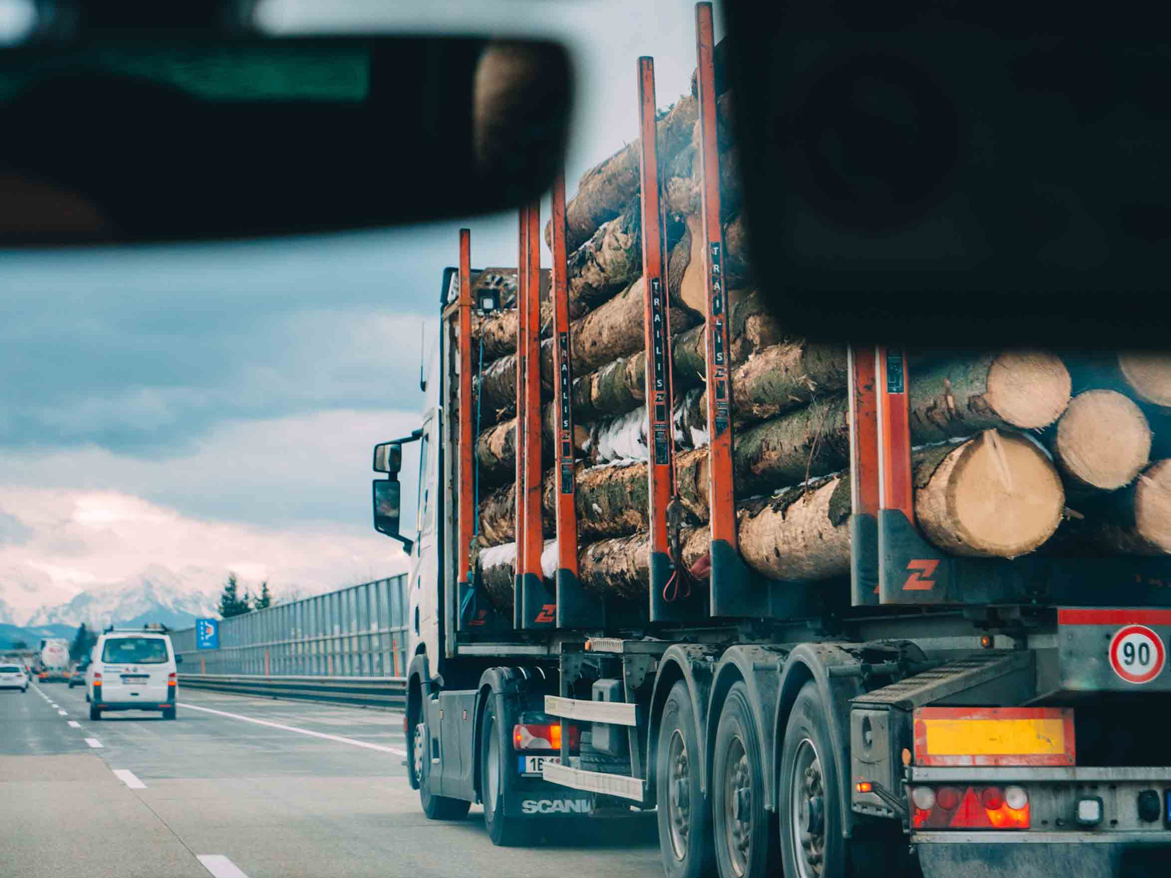 truck carrying logs of wood on the highway