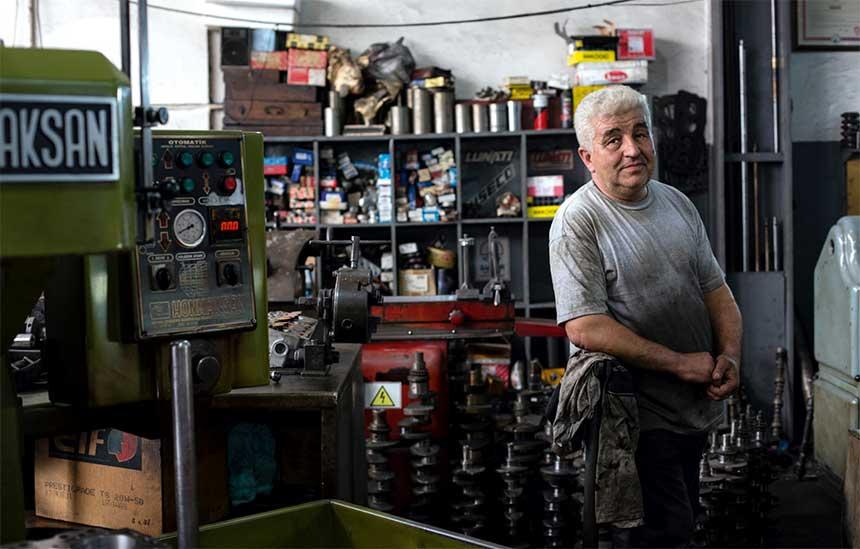 man in his workshop posing