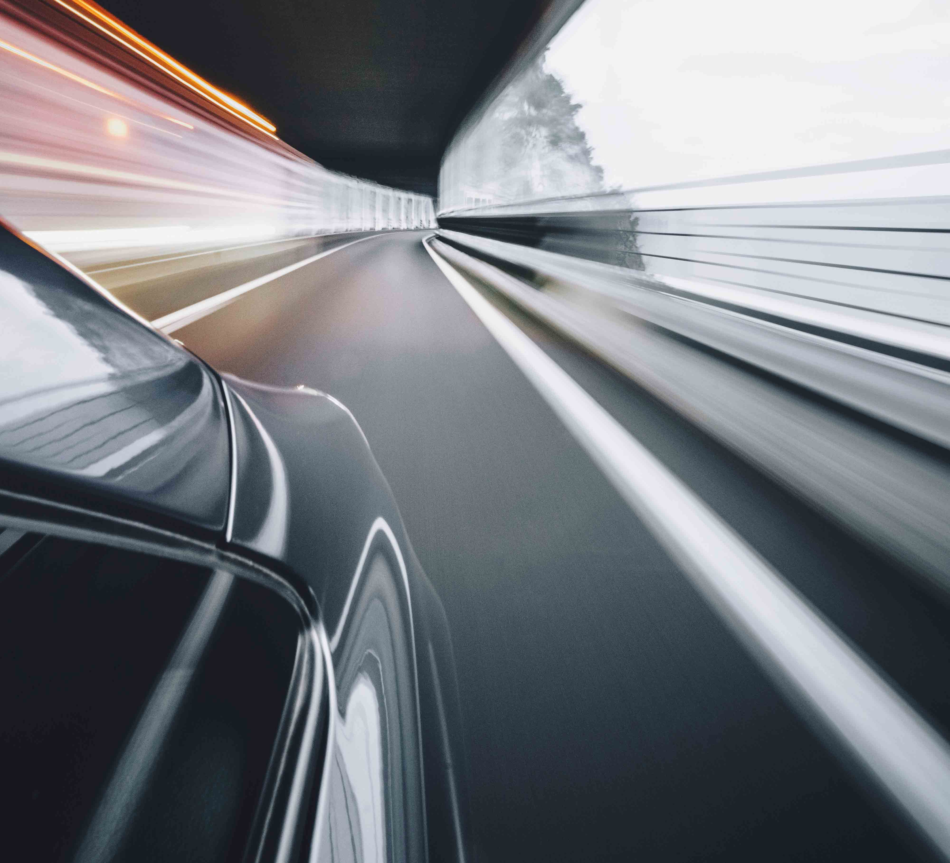 Car travelling fast through a tunnel